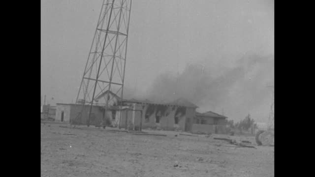 world war ii north african campaign / british soldiers injured and not / radio station building burning /radio towers behind barbed wire fence /... - mast stock videos & royalty-free footage