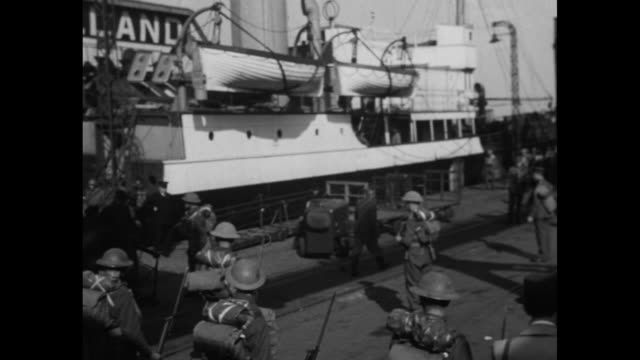 world war ii north african campaign / french and british soldiers preparing to sail / hands stuffing things into a knapsack / ficer adjusting... - north africa stock videos & royalty-free footage