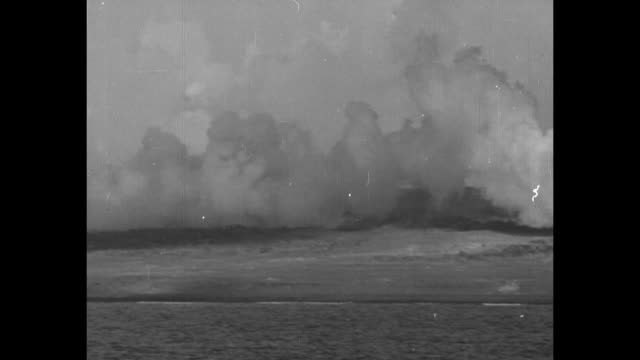 world war ii / pacific theater / aerials of iwo jima battle / many ships / plane trailing thick smoke screen / mt suribachi being bombed / aerials of... - battle of iwo jima stock videos & royalty-free footage