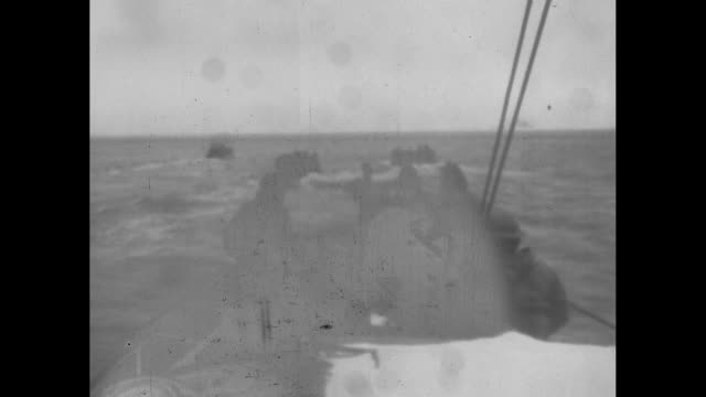 world war ii / pacific theater / aleutian islands / full landing craft approach shore of attu / soldiers on ship watch lcis / soldiers land on beach... - aleutian islands stock videos and b-roll footage