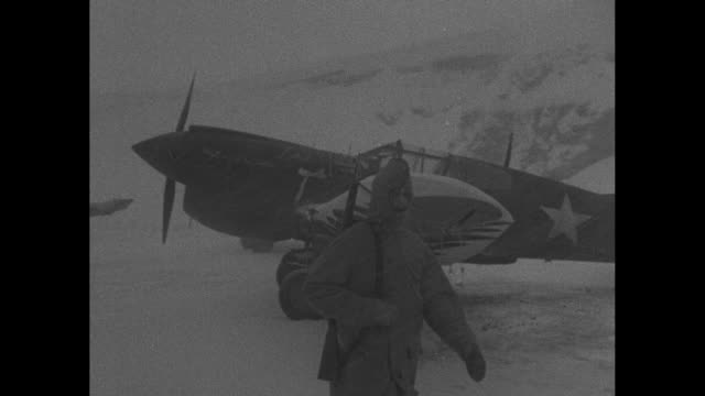 world war ii / pacific theater / aleutian islands / ws snowcapped mountains the aleutian range with plane in background / tents in snow with... - aleutian islands stock videos and b-roll footage