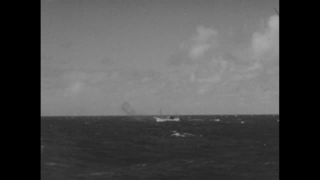 world war ii / pacific theater / american submarine attacks japanese listening station at sea / heavy black smoke from japanese boat under attack by... - pacific war stock videos and b-roll footage