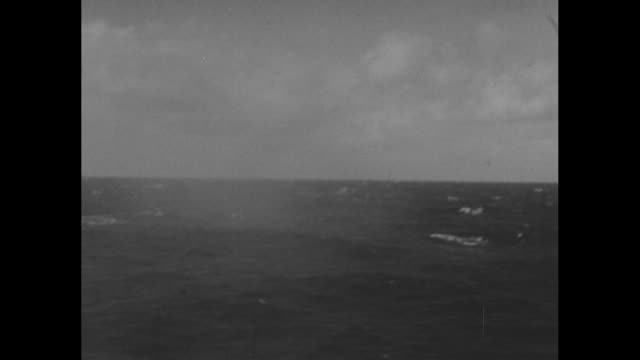 world war ii / pacific theater / american submarine in the pacific ocean attacks japanese listening station at sea / interiors of american submarine... - 軍用船点の映像素材/bロール