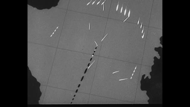 World War II / Pacific theater / animated map of Philippines showing positions of US Navy / ships firing and being fired upon / CU pilot Capt David...