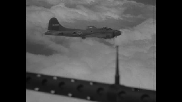 world war ii / pacific theater / b17 in air / view from gun turret of thick clouds and 2 planes / cu gunner inside turret / b17s in air / bombs... - luftangriff stock-videos und b-roll-filmmaterial