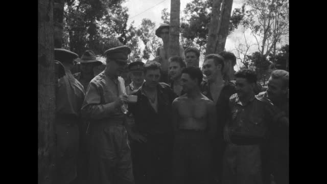 world war ii / pacific theater / group photo australian and american soldiers pose with us army general douglas macarthur / 2 jeeps driving pass... - general macarthur stock videos & royalty-free footage
