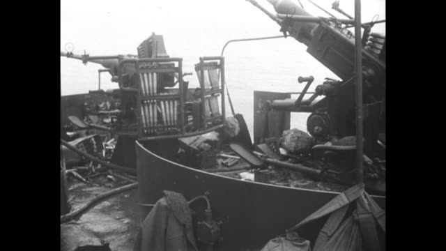world war ii / pacific theater / iwo jima / aerials of bombed landing craft infantry / dead body on deck / severely injured crewman on deck / cu lci... - battle of iwo jima stock videos and b-roll footage