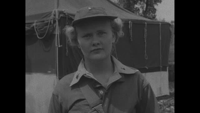 World War II / Pacific theater / line of Women's Army Corps nurses on Guadalcanal / nurses salute / CU three nurses stand together / CU three nurses...