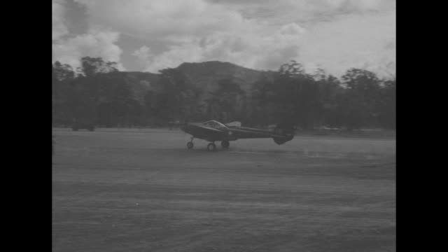 world war ii / pacific theater / planes on runway / transport us troops disembark plane / squad of 13 soldiers march past plane / plane parked at... - pacific war stock videos and b-roll footage