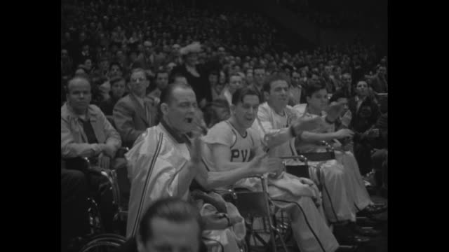 world war ii paraplegic veterans play basketball in madison square garden / patients from halloran and cushing hospitals in wheelchairs on the court... - wheelchair basketball stock videos and b-roll footage
