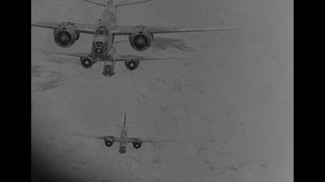 world war ii / planes in air, probably over egypt / bombs falling / aerials of explosions and planes passing above them / note: exact day not known - air raid video stock e b–roll