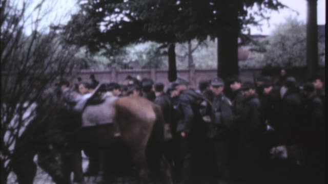 world war ii refugees repatriated by american troops waving sikh soldiers sitting german prisoners in a line being watched by gis and british... - prisoner stock-videos und b-roll-filmmaterial
