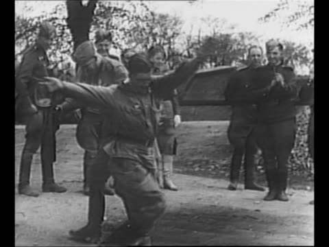 world war ii soviet soldiers dance in a circle; one holds a thompson submachine gun; other soldiers and military women watch; the soviets are... - submachine gun stock videos & royalty-free footage