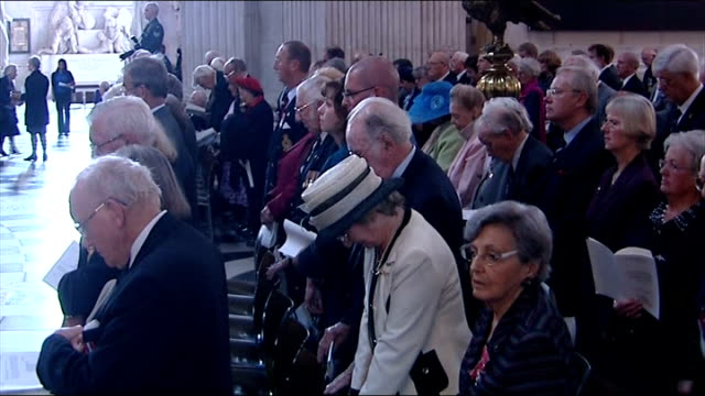 the blitz 70th anniversary service at st paul's int various of veterans and blitz survivors standing listening as air raid siren played in cathedral... - air raid siren stock videos & royalty-free footage