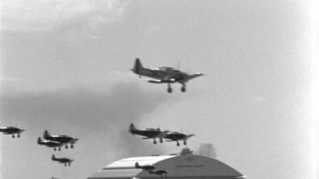world war ii trainer aircraft land at kelly field in san antonio, texas. - war stock-videos und b-roll-filmmaterial