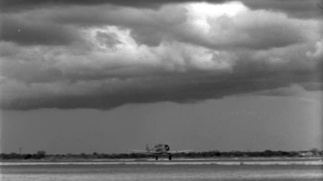 a world war ii trainer aircraft lands at an airfield in 1940. - 1940 video stock e b–roll