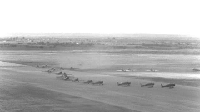 world war ii trainer airplanes taxi on a landing strip at kelly field in san antonio, texas. - war stock-videos und b-roll-filmmaterial