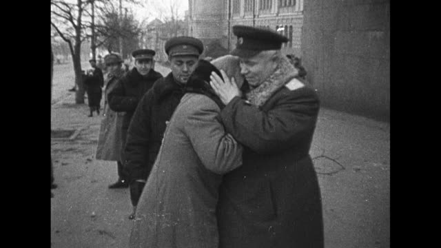 vídeos de stock, filmes e b-roll de world war ii / ukraine / soldiers marching / soviet officers walk with commissar nikita khrushchev in kiev / khrushchev comforts woman in the street... - forças aliadas