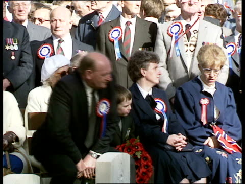 """unknown soldier honoured; war veterans arriving at cemetery for service and pamphlet held """"in memory of frank godwin"""", and frank godwin jnr. stands... - pamphlet stock videos & royalty-free footage"""
