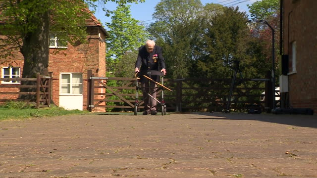 world war ii veteran tom moore taking part in a sponsored walk of 100 laps of his garden which has raised over £1m for the nhs - part of stock videos & royalty-free footage