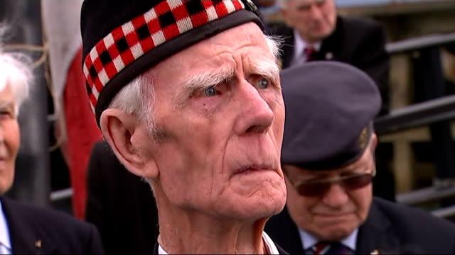 world war ii: veterans mark 70th anniversary of d-day landings; portsmouth: ext john millin being welcomed close shot veteran looking on john millin... - war veteran stock videos & royalty-free footage