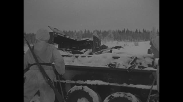 world war ii / winter war / finnish soldier with horse / soldiers on skis between discarded tanks / soldiers inspecting tanks / bombed buildings /... - finlandia video stock e b–roll