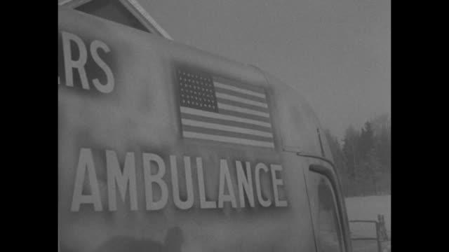 vídeos de stock, filmes e b-roll de world war ii / winter war / group of men from american volunteers ambulance / robert newman, william mock, john hasey and lewis bartlett / each... - world war ii