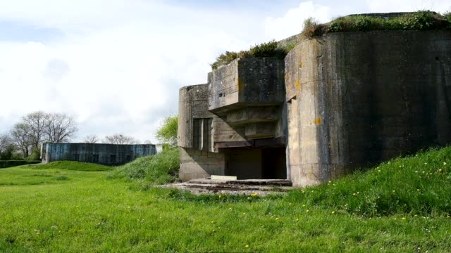 a world war iiera german artillery bunker that points towards the english channel stands in normandy on april 29 2019 at azeville france june 6 will... - d day stock-videos und b-roll-filmmaterial