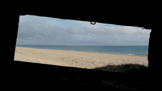 world war ii-era german bunker looks out at utah beach in normandy on may 2, 2019 near sainte-marie-du-mont, france. june 6 will mark the 75th... - world war ii stock-videos und b-roll-filmmaterial