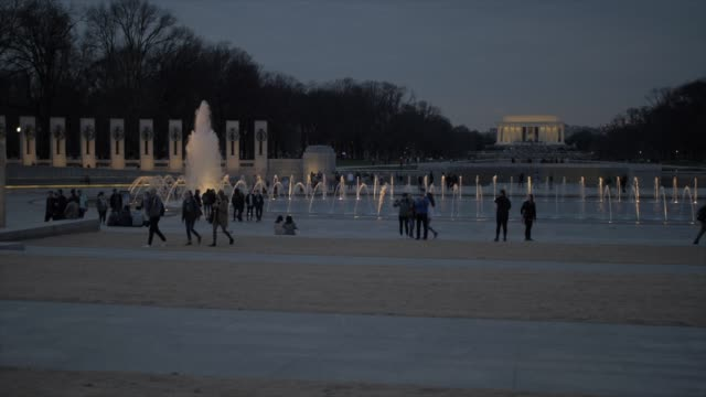 world war ll and lincoln memorial at dusk, washington dc, united states of america, north america - world politics stock videos & royalty-free footage