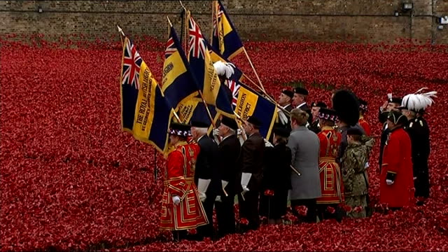 World War One Centenary Armistice Day commemorations 'Last Post' played and soldiers lower flags