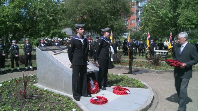 world war one sailor jack cornwell recognised **music heard sot** ab alex saridis and other naval officers at ceremony as david cornwell laying... - 花輪を捧げる点の映像素材/bロール