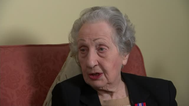 DDay landings switchboard operator to receive Legion d'honneur ENGLAND INT Marie Scott set up shot with reporter / interview SOT