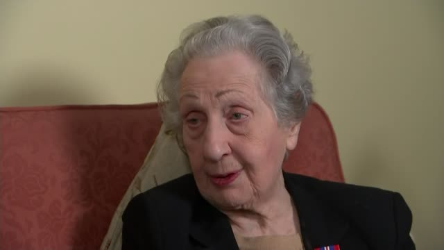 DDay landings switchboard operator to receive Legion d'honneur ENGLAND INT Marie Scott interview SOT Scott and reporter chatting Medal Scott