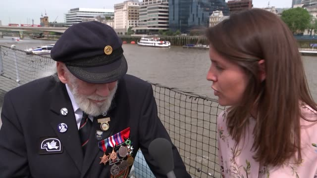 DDay survivor Jim Radford and songwriter recounts traumatic experience ENGLAND London HMS Belfast EXT Jim Radford interview SOT / Reporter to camera...