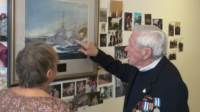 DDay veteran awarded the Legion d'Honneur ENGLAND London Mitcham INT Various of DDay veteran John Nicholls and his daughter Linda Briers looking at a...