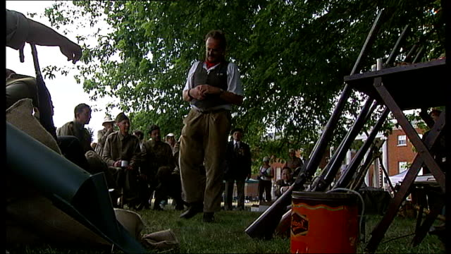 world war two home guard training school recreated at osterley park british home guard kit displayed man taking photograph general view of men seated... - home guard britannica video stock e b–roll