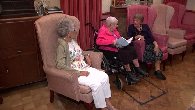 New book celebrates role of women in Stepney during war ENGLAND London Stepney INT Various of women seated chatting at Jewish Care Community Centre