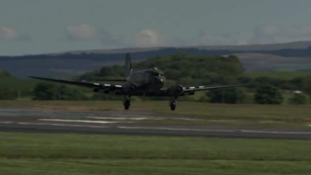 us plane that took part in dday restored in time for 75th anniversary flypast scotland south ayrshire prestwick ext plane coming in to land plane... - d day stock videos and b-roll footage