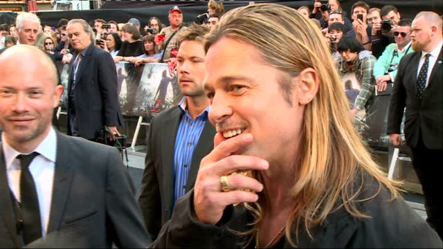 'world war z' film premiere red carpet; brad pitt interview sot / crowds in leicester square / brad pitt gvs being interviewed - brad pitt actor stock videos & royalty-free footage