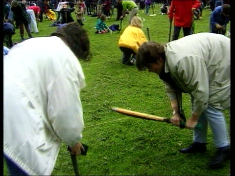 itn england nr crewe willaston ext man counts down to start of championships i/c with charmers in b/g two children attempting to charm worms by... - netting stock videos & royalty-free footage