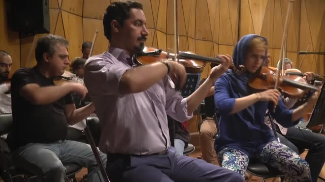 World Youth Orchestra and Tehran Symphony Orchestra's performers rehearse ahead of classical music concert at Roudaki HallVahdat Hall in Tehran Iran...