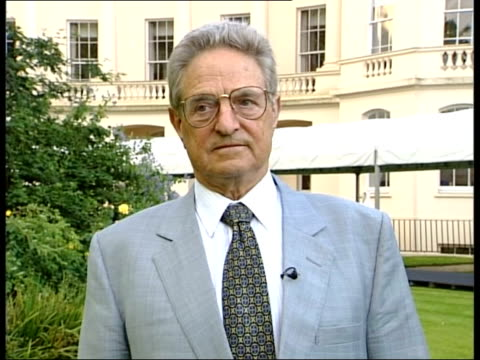 confidence effects; england: central london: ext george soros interview sot - we know steps that need to be taken and it could be avoided/ markets... - worldcom stock-videos und b-roll-filmmaterial