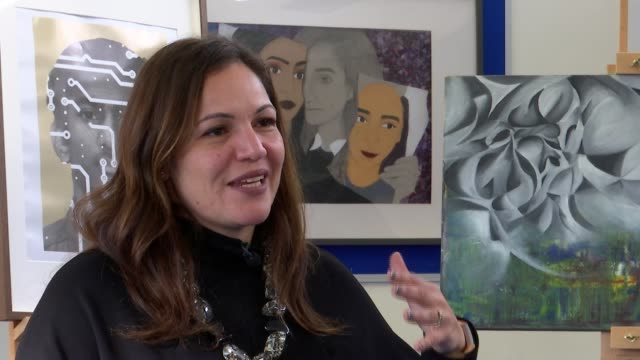 World's Best Teacher winner Andria Zafirakou interview ENGLAND London Alperton INT Andria Zafirakou setup looking at artwork with pupils and...