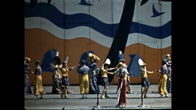 world's fair aquacade follies large photos of performers olympic swimmer eleanor holm the 'aquagals' johnny tarzan weismuller / crowd in stadium... - swimming costume stock videos & royalty-free footage