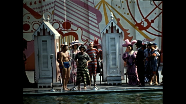 world's fair aquacade johnny weismuller speaking at microphone costumed clown firemen weismuller on diving board with billy kreuger / kreuger hanging... - exhibition stock videos & royalty-free footage