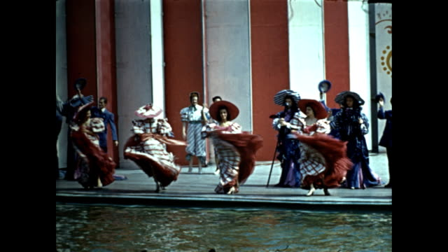world's fair aquacade men performing stunt high dives past orchestra in alcove / somersaults backflips / men and women in victorian costumes dancing... - exhibition stock videos & royalty-free footage