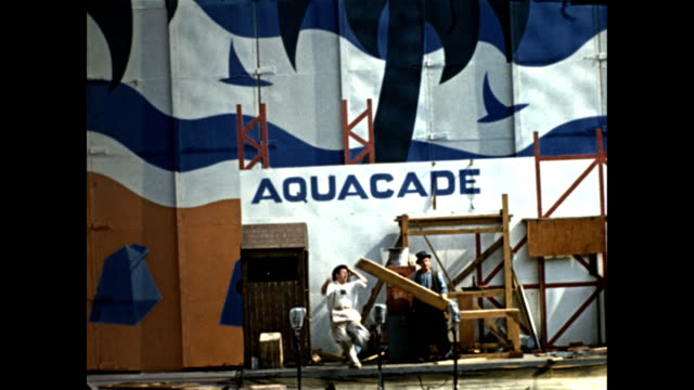 world's fair aquacade slapstick comedy act comedians dressed as construction workers perform choreographed physical comedy routine with boards fake... - exhibition stock videos & royalty-free footage
