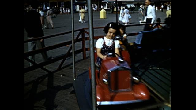 world's fair children's world children riding ferris wheel children on car carousel ride huskies pulling children in wheeled cart in eskimo village... - american eskimo dog stock videos & royalty-free footage