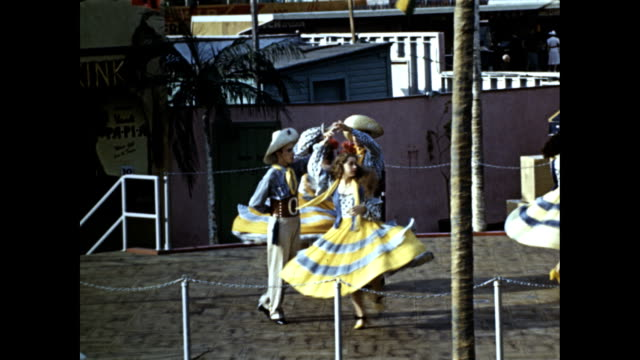 world's fair cuban village men and women in costumes men in ruffled sleeves women in bikinis and dresses performing traditional cuban dances on... - cuban culture stock videos & royalty-free footage
